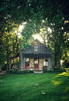 Gorgeous wood cabin. Who wants to relax by a fire pit in this setting?