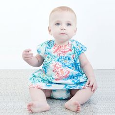 Phoenix And The Fox Charlotte dress is printed in an exclusive Peoniesdesign.  It is 100% breathable cotton, Made from high quality and beautifullysoft.  Dress has elasticated short sleeves and button closure down the back.  Dress is fully lined.