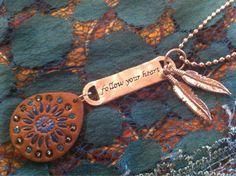 Bohemian leather and silver charm necklace with feather charms and follow your sreams charm on Etsy, $12.95