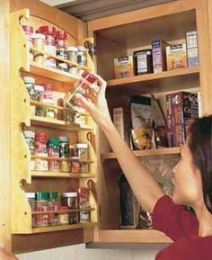 DIY Cabinet Door-mounted spice rack.  Don't think my kitchen cabinets have the space for this- but it would be nice!