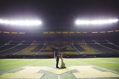 Dream come true for these two... and us via Michigan Wedding Photographers, Silver Thumb Photography, silverthumbphoto.com, Ann Arbor Wedding Photographer, The Big House, Michigan Stadium, U of M