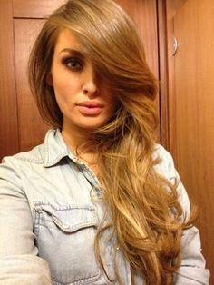 Light Caramel Brown / Dark Caramel Blonde with a few golden highlights.