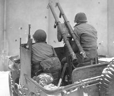 """A US """"anti-tank"""" Willis jeep. Twin M1A1 bazookas installed on a machine gun pole. The unit ironmonger has provided the impromptu shields for driver and passenger. This element belonged to 60th Regiment of the 9th Infantry Division. Photo taken on Jan 16, 1945 somewhere in Belgium."""