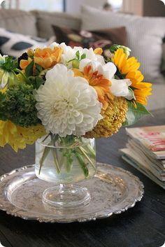 Pretty flowers on a silver platter.