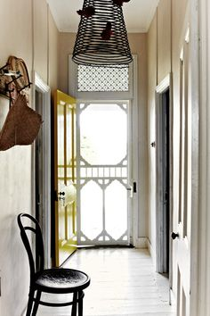 Screen Door Hallway White painted floors and walls give the hallway a fresh feel. The bentwood chair is from a Talbot farmers' market. White Painted Floors, Wood Screen Door, Privacy Screen Outdoor, Interior And Exterior, Interior Design, Yellow Doors, Old Cottage, Bentwood Chairs, Beautiful Interiors