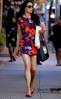 Do they ever end?: Famke Janssen did a great job of flaunting her endless legs and phenomenal body as she took a stroll in New York City on Friday