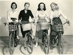 Jean Simmons, Joan Fontaine, Piper Laurie and Sandra Dee ride bikes. (And Sandra Dee tries not to lose her head.)    Tags: Jean Simmons Joan Fontaine Piper Laurie Sandra Dee Until They Sail Warner Bros. 1957