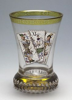 """Ranftbecher.Anton Kothgasser Vienna c. 1820   Ground clear glass, partially glazed yellow, colored  painted, front three playing cards """"Trull"""" of Tarokspiels  with three trumps Sküs, moon and Pagat  conical wall on vertical geschlägeltem Ranft, lip with  floral border, back golden lettering """"Leur union est  notre force """", in the ground floor"""