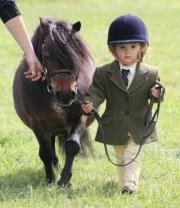 Ready to go. Little equestrian rider.