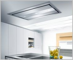 Modern minimalist design, total unobtrusiveness and powerful suction are main features of these ceiling kitchen hoods by Gutmann. Estrella II above and Campo II below [. Kitchen Vent Fan, Kitchen Extractor Fan, Round Kitchen, Kitchen Hoods, Kitchen Exhaust Fan, Kitchen Stove, Kitchen White, Kitchen Appliances, Ceiling Mount Range Hood