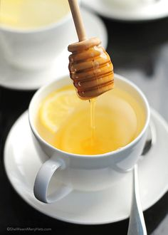 Lemon Ginger Tea with a bit of honey is easy to make at home and can help relieve cold and flu symptoms. Plus it's delicious too!