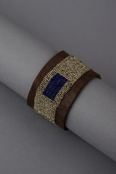 Embroidered leather cuff - vintage metal seed beads and lapis . $355.