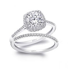This petite engagement ring design features a cushion shaped halo and diamonds on the shoulders of the ring.