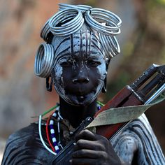 Ethiopia; Mursi Woman and her kalachnikov // p by claude gourlay