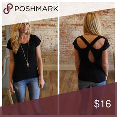 """Black cross over back top Modeling size small. 95% rayon 5% spandex. Bust laying flat: S 18"""" M 19"""" L 20"""" length S 24"""" M 25"""" L 26"""". Add to bundle to save when purchasing two or more items from my closet. HH3220819 Tops Tees - Short Sleeve"""