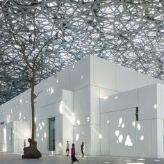 The first official photographs of the Jean Nouvel-designed Louvre Abu Dhabi have been released ahead of the art museum's public opening on Saturday.
