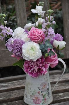 country flower arrangement ideas | simple hand tied arrangement of mixed flowers in a pretty container ...