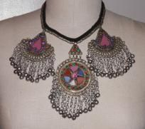 This offer is for a beautiful bold vintage indian enamel necklace. It makes a real statement when worn. The drop chains have a small bell at the end. Not excessively loud, just enough to hear. 3 Geometrical patern pendants.  The necklace is a true...