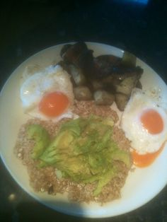 Healthy breakfast,organic rolled oats made into an oatcake,topped with chopped avocado,organic brown eggs,organic portabella mushrooms and cooked chopped potatoes.