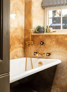 We are a leading firm of residential architects specialising in designing contemporary new homes and period renovations in London, Surrey and the South East Marble Wall, Gold Marble, Wall Tile, Gold Taps, Architects London, Standing Bath, Timber Structure, Concrete Steps, Residential Architect