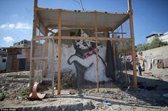 Among the devastation graffiti artists have moved in to leave their mark