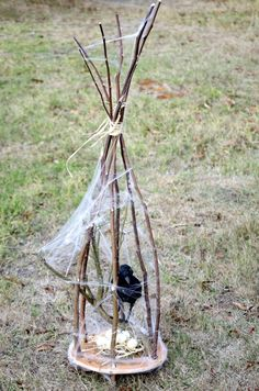 Creepy twig cages...for any little creepy creature. This could be cool with a shrunken head or skull inside....maybe even a creepy doll.