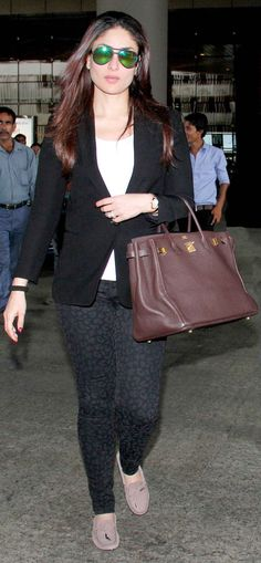 Kareena Kapoor looked stylish in a blazer with shades and an enviable Hermes Berkin tote on her arm and Tod's pink loafers.