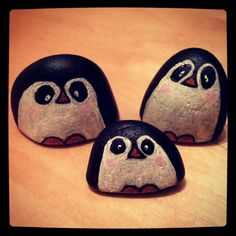 Hand painted stone penguin family