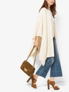 Shaker stitching offers a textural richness to this easygoing poncho. Knit from merino wool and cashmere, it adds effortless movement to jeans, leggings and more.