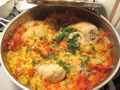 "Arroz Con Pollo or Chicken with Rice. Puerto Rican version. Note: Alcaparras are capers. You can google Puerto Rican Sofrito and find a recipe for it. Each country's recipe for sofrito is a little different. Pegao refers to the ""burnt rice"" at the bottom of the pot. It's considered a treat by many. I would brown the chicken in a very hot skillet first to give it more color."