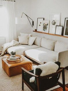 modern family room decor with modern white sofa and leather ottoman coffee table moderne Einrichtung My Living Room, Living Room Furniture, Living Room Decor, Rustic Furniture, Apartment Furniture, Antique Furniture, Furniture Stores, Cheap Furniture, Coffee Table For Small Living Room