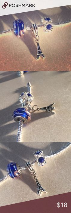 ❕❗️ Bundle of 3 charms ***NOT PANDORA*** charms will fit on Pandora Bracelets! Includes a beautiful blue glass charm with gold designs, dangling Eiffel Tower charm and a blue rhinestone charm! New condition. Pandora Jewelry Bracelets