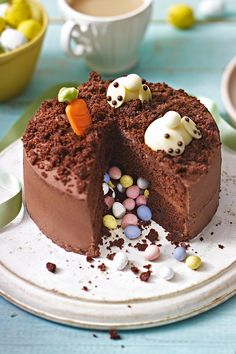 Try the Waitrose Burrowing Bunnies Pinata Cake and impress guests with this charming, chocolatey cake. Avaliable in store