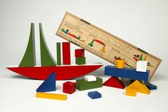 """""""During her training at the legendary Bauhaus in 1924, Alma Siedhoff-Buscher designed this building game, as part of the children's room in the model house """"Am Horn"""" in Weimar. It was produced in different versions afterwards in the Bauhaus workshops. Naef has been producing this historic item as a replica since 1977."""""""