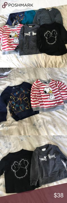 6x Toddler Sweatshirts size 3T 6x Sweatshirts/Sweater in size 3T. All in good, clean condition. 1) Ralph Lauren navy with purposeful faded horsebit print. 2) Gap x peanuts red striped with textured snoopy appliqué. 3) Old Navy x Disney 3/4 sleeve, hi-low hem black with silver Minnie outline. 4) jcrew charcoal with silver dachshunds. 5) Old Navy 3/4 sleeve lace trim swing sweater in teal. 6) Old Navy gray quilted hi-low hem tunic. Old Navy Shirts & Tops Sweatshirts & Hoodies