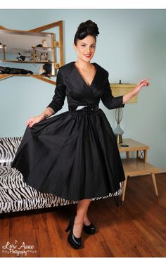 Birdie Dress with Three Quarter Sleeves in Black Sateen-Our popular Birdie Dress - with three-quarter sleeves and in comfortable sateen! The Birdie has a wide notched collar with a cross-over bust line, a back zipper, a cinched waist with wide vinyl belt, and a full circle skirt. This classic 1950s silhouette looks fabulous on every body type! - See more at: http://www.pinupgirlclothing.com/birdie-black-sleeves.html#sthash.0XFEsZnS.dpuf