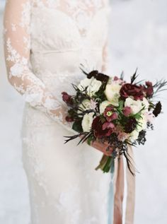 Moody colors made up this bouquet of scabiosa, berries, and more.
