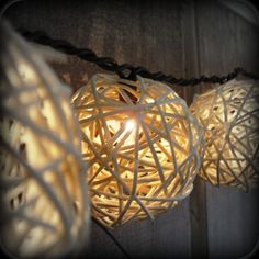 DIY Rattan Ball Patio Light Strand! Cost is $1 plus tax. Dollar Tree, and other dollar outlets, sell these grapevine deco balls by the bag.  Take one of your strings of white Christmas lights, pop the rattan balls over each bulb, hang it up and plug it in!  These deco string lights cost a lot when bought in retail stores.  You can make your own and pocket the bucks for other DIY fun projects!  Pssst! Use up some of the spray paint you have,  or use colored lights, and change these up!