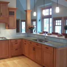 Craftsman Kitchen. Our cabinet slight backsplash, light counter.  Like better than dark counter.