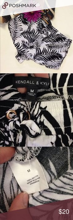 Kendall and Kylie palm leave shorts In excellent gently used condition. These are a reposh as I didn't like how they fit on me. Tag says medium but fit more like a small in my opinion. Tie drawstring at the waist. Would be perfect for the beach or a summer night out! Kendall & Kylie Shorts