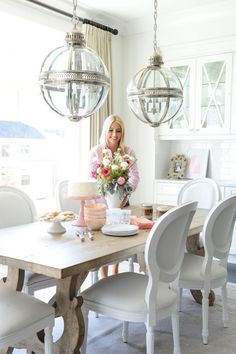 Two globe chandeliers over dining table
