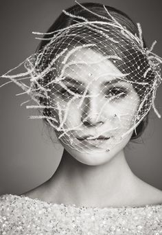Some well-placed plumes turn a simple birdcage veil into a serious fashion moment. http://www.aislestyle.co.uk