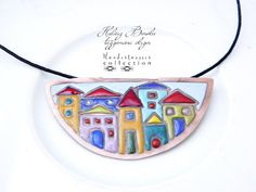Colorful little houses, in irregular form, closed into a semi-circle. Enamel necklace, made absolutely by hand. The copper is antiqued and