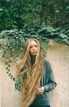 super long hair...all I can think is how much it would hurt to get untangled from the ivy! Ouch!