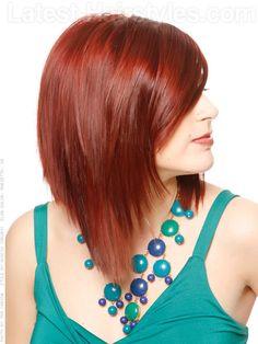 Red hair, inverted bob, side fringe.