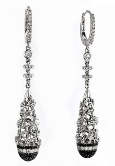 Black and white diamond earrings set in 18k white gold. Contains .95 total carats of round white diamonds and.50 total carat weight of black diamonds. Pink Diamond designs- LQ7004E. Available at Murphey the Jeweler.