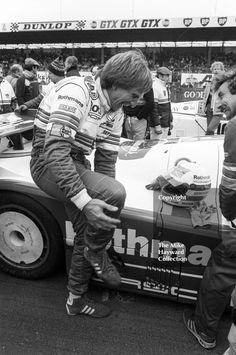 Derek Bell enjoys a joke on the grid before sharing a Rothmans Porsche 956 with Stefan Bellof and finishing 10th, World Endurance Championship, 1985 Grand Prix International 1000km meeting, Silverstone. #sportscars