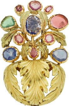 Sapphire, Gold Brooch, Buccellati The brooch features blue, pink and green pear and oval-shaped sapphires, set in 18k gold, completed by a double pinstem and hook, marked Buccellati, Made in Italy. Gross weight 16.74 grams.