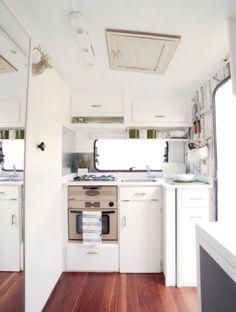 I really like the stark white inside this renovated camper/ travel trailer