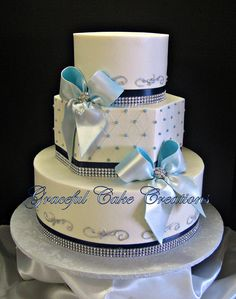 Elegant White Wedding Cake with Navy Blue and Bling Ribbon with Ice Blue Bows | Flickr - Photo Sharing!